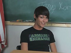 Lovely young twink pornstar Trey Korbin is sitting at a desk wearing a t-shirt and looking totally hot gay teens first time sex at Teach Twinks